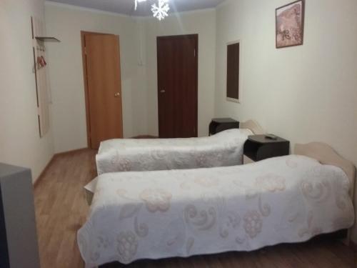 Кровать или кровати в номере Мини-Отель Грааль