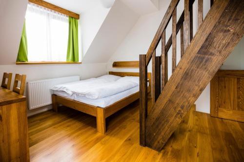 Postel nebo postele na pokoji v ubytování Penzion U Barana