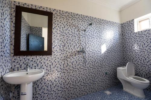 A bathroom at Kite&Active Guesthouse