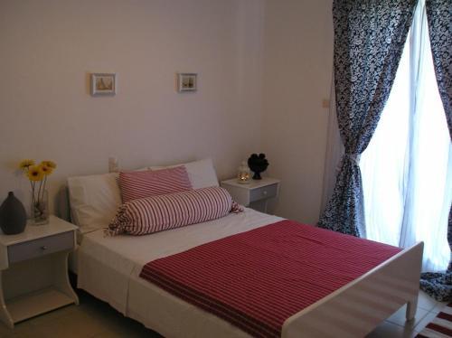 Ένα ή περισσότερα κρεβάτια σε δωμάτιο στο Pefki Villas