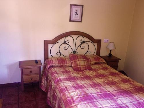 Cama o camas de una habitación en Hostal Bar Stop