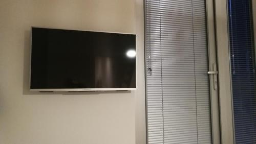 A television and/or entertainment center at Apartment Cyclades Free Parking