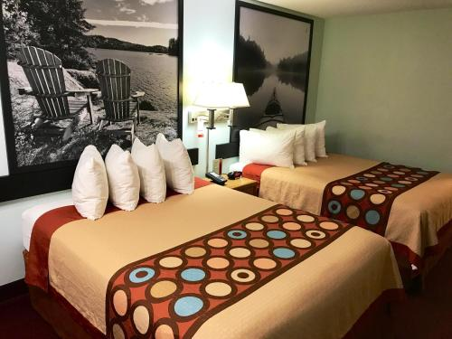 A bed or beds in a room at Super 8 by Wyndham Kindersley