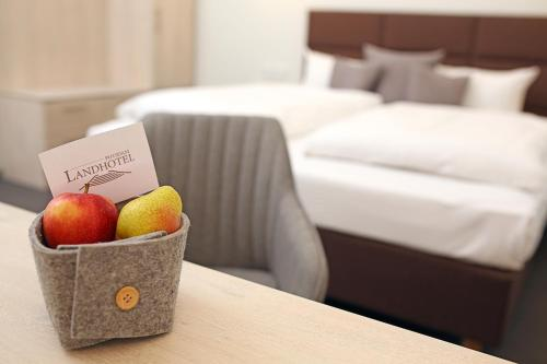 A bed or beds in a room at Landhotel Potsdam