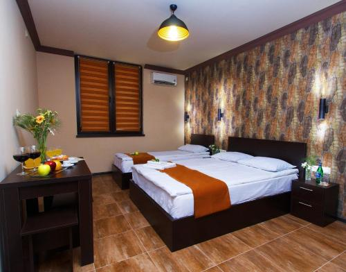 A bed or beds in a room at WOW Guest house in apartment 141