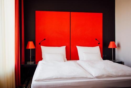 Кровать или кровати в номере Angelo by Vienna House Екатеринбург
