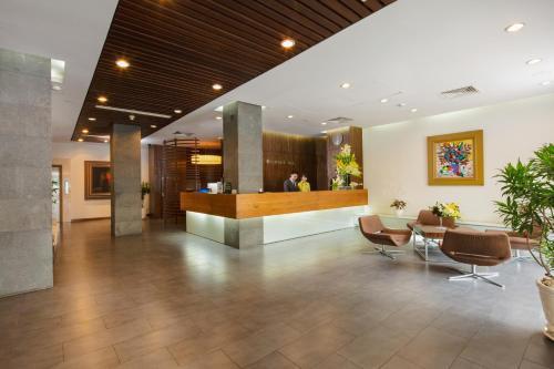 The lobby or reception area at Norfolk Hotel Saigon