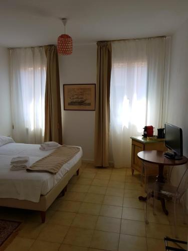 Cama ou camas em um quarto em Butterfly Guest House