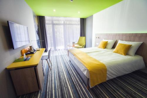 A bed or beds in a room at Park Inn By Radisson Zalakaros Hotel & Spa