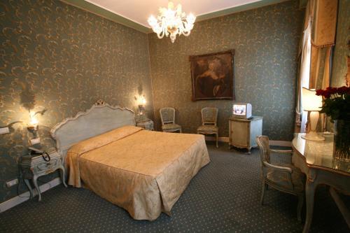 Cama ou camas em um quarto em Locanda Ca' del Brocchi