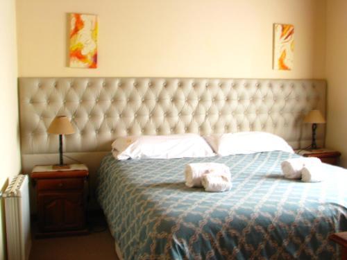 Una cama o camas en una habitación de Don Gregorio