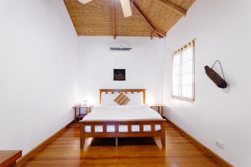 Ein Bett oder Betten in einem Zimmer der Unterkunft The Strand Boracay