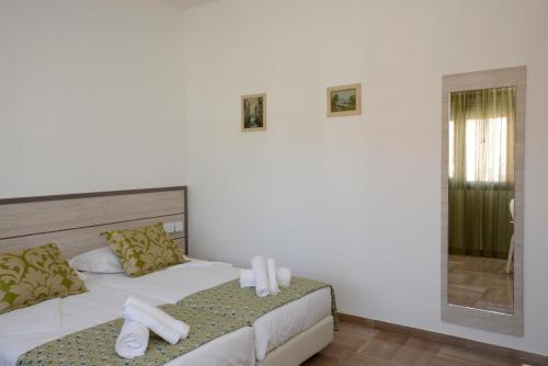 A bed or beds in a room at BB Venice Cinzias'