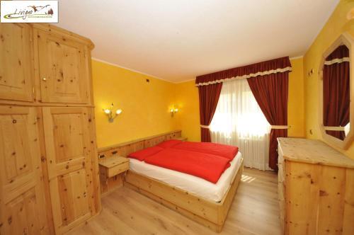 Letto o letti in una camera di Alpen Royal