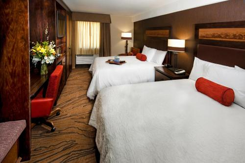 A bed or beds in a room at Hampton Inn Jackson Hole