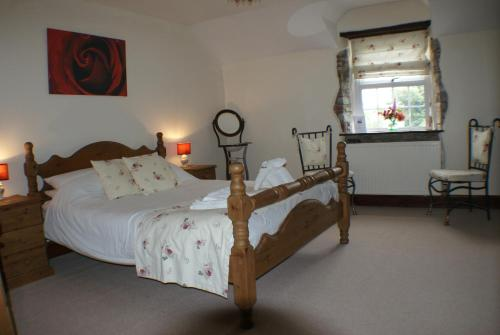 A bed or beds in a room at Great Philham House B&B