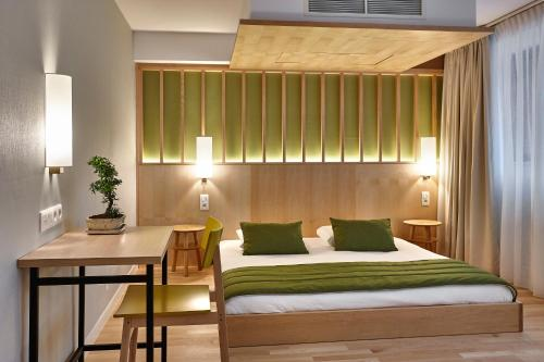 A bed or beds in a room at Yadoya Hotel
