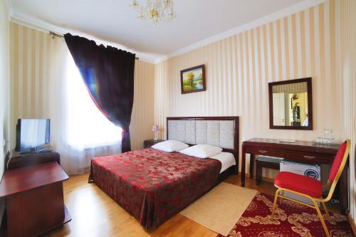 Кровать или кровати в номере Гостиница Северная
