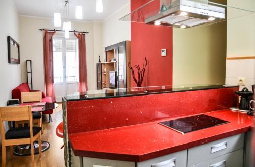 Una cocina o zona de cocina en Alameda San Lorenzo Loft