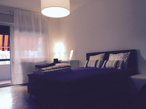 A bed or beds in a room at Apartment Canevascini
