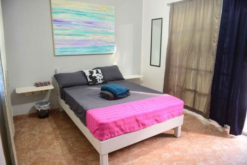 A bed or beds in a room at Villa espectáculo B&B