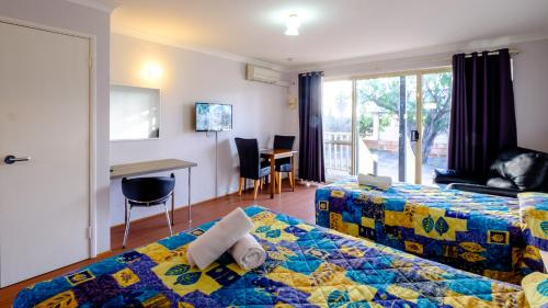 A bed or beds in a room at Australind Tourist Park