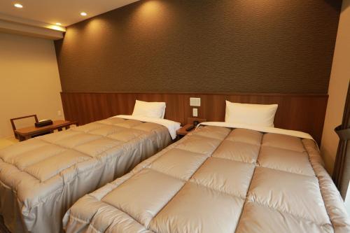 ザ ベース 堺東 アパートメントホテルにあるベッド