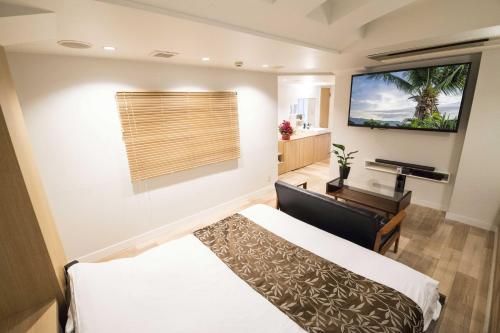 ホテルアトラス 新宿歌舞伎町 (大人専用)にあるベッド