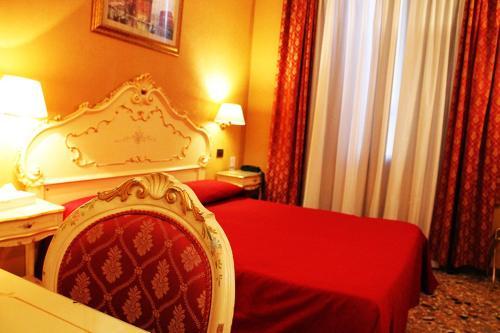 Cama ou camas em um quarto em Locanda Poste Vecie