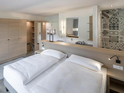 Ein Bett oder Betten in einem Zimmer der Unterkunft Hotel Matteo