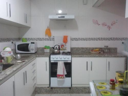A kitchen or kitchenette at Flat ed São Gonçalo
