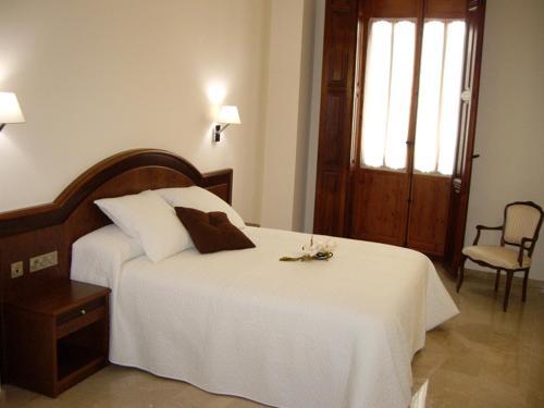 Cama o camas de una habitación en Hotel San Sebastián Hospedería