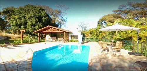 The swimming pool at or near Pousada do Lago