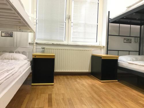 Cama o camas de una habitación en Hostel Tresor