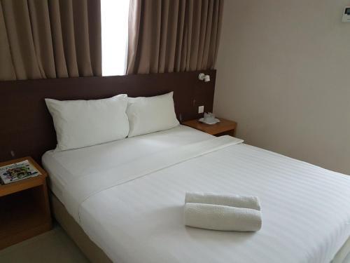 Katil atau katil-katil dalam bilik di Hotel Asia