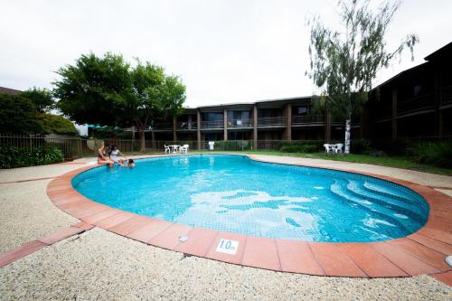 The swimming pool at or near Sandown Regency Hotel & Apartments