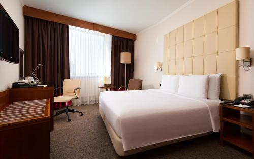 A bed or beds in a room at DoubleTree by Hilton Novosibirsk