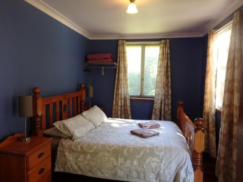 A bed or beds in a room at Teretre Cabins Nimbin