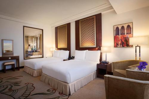 A bed or beds in a room at Conrad Dubai