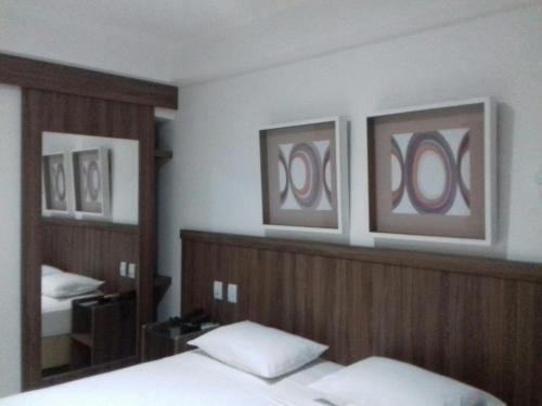A bed or beds in a room at Pratti Hotel
