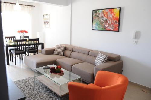 A seating area at Kiti Deluxe Apartments