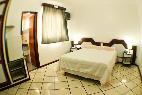 A bed or beds in a room at Shalako Hotel