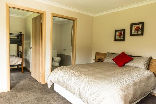 A bed or beds in a room at Sunny Gum