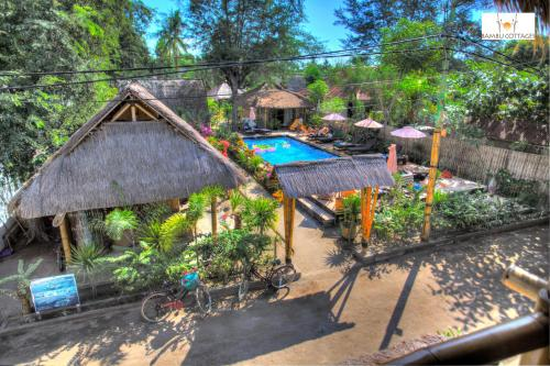 A view of the pool at Bambu Cottages or nearby