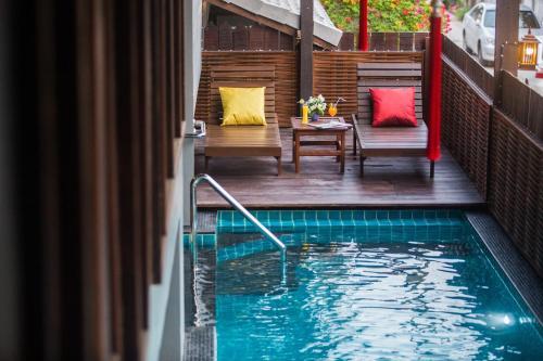 The swimming pool at or near Night Bazaar Inn