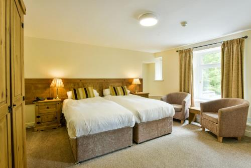 A bed or beds in a room at Edenhall Country Hotel
