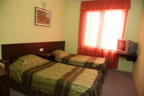 A bed or beds in a room at Hotel Avramov