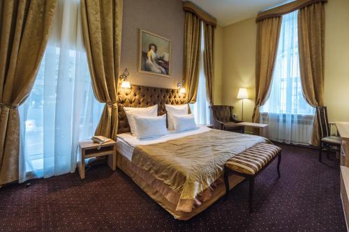 Кровать или кровати в номере Гостиница Парадная