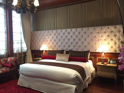 A bed or beds in a room at The Orchids
