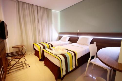 A bed or beds in a room at Express Vieiralves